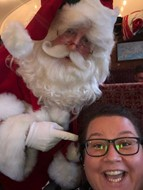 Caroline is having a word with Santa